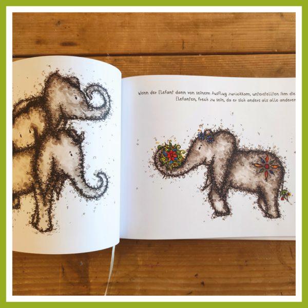 Blick ins Schmetterfantenbuch - Elefant kommt mit Blumen zu seiner Herde.