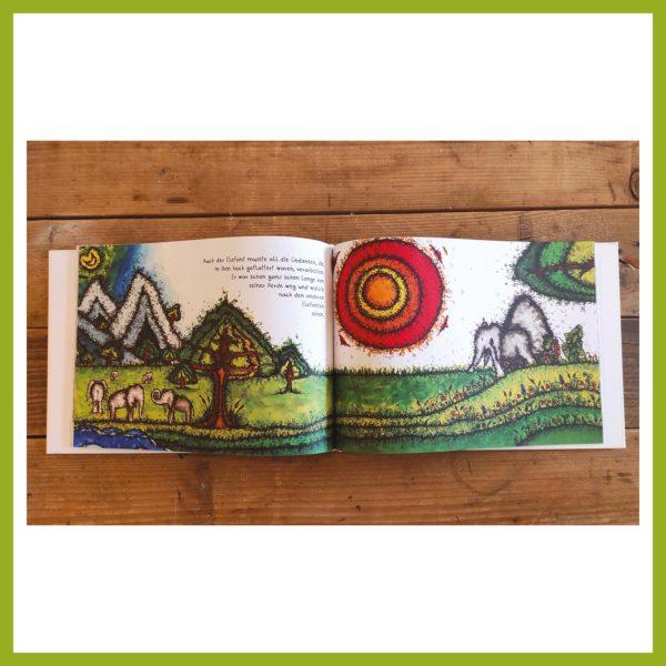 Blick ins Schmetterfantenbuch - Doppelseite Herde und Elefant in der Landschaft.
